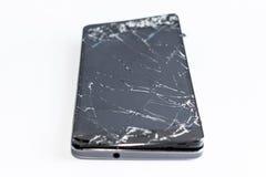 Mobiltelefon med den brutna skärmen Fotografering för Bildbyråer