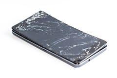 Mobiltelefon med den brutna skärmen Arkivbild