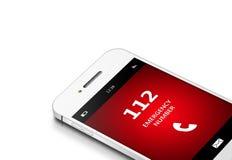 Mobiltelefon med nöd- nummer 112 över vit Arkivbild