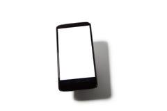 Mobiltelefon med skugga Fotografering för Bildbyråer