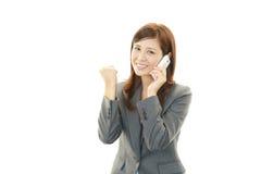 Mobiltelefon och affärskvinna. royaltyfria foton