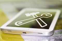 Mobiltelefon och ett symbol av service Arkivbilder