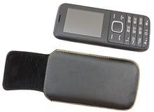 Mobiltelefon och fall på ett vitt royaltyfria foton