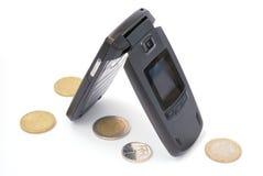 mobiltelefonen coins euro Arkivfoton
