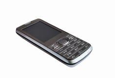 Mobiltelefonen på en vit bakgrund Royaltyfri Bild