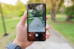 Mobiltelefonen rymms, fotografikorridoren Arkivfoto