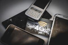Mobiltelefoner och logo 4g royaltyfri bild