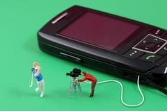 Mobiltelefonunterhaltung Stockbild