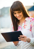 Mobilty - woman with tablet on street Stock Images