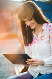 Mobilty - woman with tablet on street Royalty Free Stock Photo