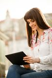 Mobilty - woman with tablet on street Royalty Free Stock Image