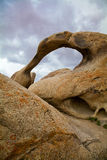 Mobius Arch, Alabama Hills, California. Sandstone arch and stormy sky Royalty Free Stock Photos