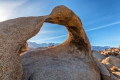 Mobius Arch at Alabama Hills near Lone Pine. Mobius Arch on sunset with Whitney mountain on background. Alabama Hills, Eastern Sierra Nevada Mountains, Lone Pine Royalty Free Stock Photo