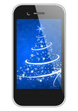 Moblie phone with christmas tree Stock Images