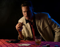 Mobster with cigar, playing poker Stock Images