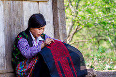 MOC CHAU PLATEAU, VIETNAM - FEBRUARY 5, 2014 - An unidentified ethnic woman lacing scarves Stock Photos