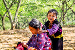 MOC CHAU PLATEAU, VIETNAM - FEBRUARY 5, 2014 - An unidentified ethnic woman lacing scarves Royalty Free Stock Images
