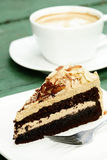 Mocha almond cake and hot coffee Stock Images