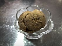 Mocha brown chocolate ice cream on cup of steel with light. Image Stock Photo