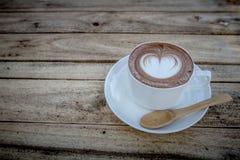 Mocha coffe on wood table stock image
