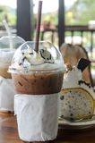 Mocha ice coffee in glassware and cake Royalty Free Stock Image