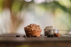 Mocha muffins and ingredients on a rustic wooden table Stock Photo