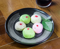 Mochi cakes on black dish Royalty Free Stock Image