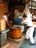 Mochi Pounders. Men pounding Mochi, a soft rice-based substance used in many Japanese dishes and made from repeatedly pounding rice.  Nara, Japan Stock Photos