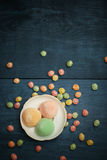 Mochi rice cakes in white plate with colorful fruit candy drops Stock Photo