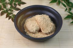 Rice cake powdered with soybean flour. Mochi which roasted or boiled in soup: with which is produced by grinding roasted soybeans in a mortar into powder royalty free stock photography