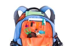 Mochila anaranjada y azul de la escuela de los niños Imágenes de archivo libres de regalías