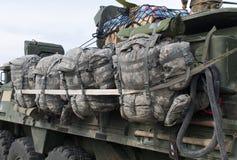 Mochilas en un M1126 ICV de la caravana de la OTAN Fotos de archivo libres de regalías