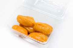 Mock jack fruit seeds in the clear plastic box horizontal 1. Mock jack fruit seeds is the traditional dessert of Thailand. Made from nuts and eegs Stock Image