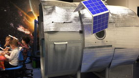 Mock spacecraft with solar panels in the classroom for children to learn stock video