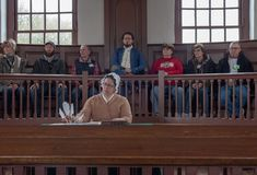 Mock Trial Underway in Williamsburg. Williamsburg, VA, USA -- January 9, 2019. Actors in period costume, surrounded by tourists, stage a mock trial in colonial stock images