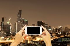 Mock up for advertising with Bangkok building at night time. Mock up on screen smart phone for advertising with Bangkok building at night time stock photography
