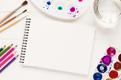 Mock up with artistic tools on white table Royalty Free Stock Images