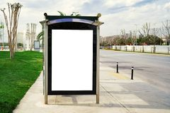 Mock up Billboard Banner template at Bus Shelter Media outdoor street. Billboard, banner, empty, white at a bus stop. Mock up Billboard Banner template at Bus stock photo