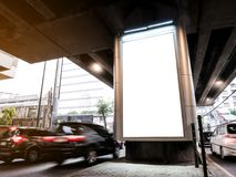 Mock up Billboard Media Light box outdoor street with Road and c. Ars moving Sign display stock photo