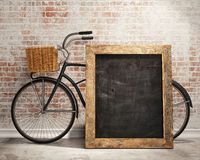 Mock up black board in loft interior background with bicycle. Template design, 3D render Royalty Free Stock Images