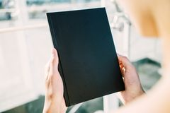 Mock up of black book in hands Royalty Free Stock Images
