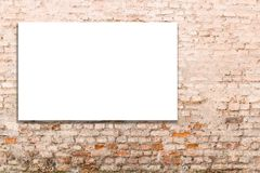 Mock up. Blank billboard, advertising, public information board on old red brick wall Royalty Free Stock Image