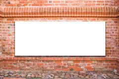 Mock up. Blank billboard, advertising, public information board on old red brick wall Stock Photography