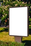 Mock up. Blank billboard outdoors, outdoor advertising, public information board in the city. Royalty Free Stock Photography