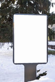 Mock up. Blank billboard outdoors, outdoor advertising, public information board in the city winter time Stock Images