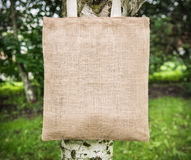 Mock up blank cotton bag. On the tree outdoor stock photos