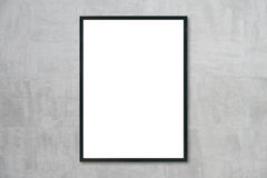 Mock up blank frame hanging on wall in room Royalty Free Stock Photos