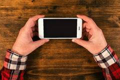Mock up blank mobile smart phone screen in female hands Royalty Free Stock Image