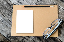 Mock up blank notebook and  pencil on wood Royalty Free Stock Image