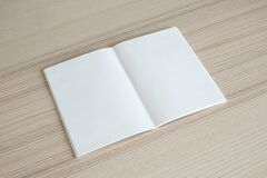 Free Mock Up Blank Open Paper Book On Wood Table Background Stock Images - 180875434